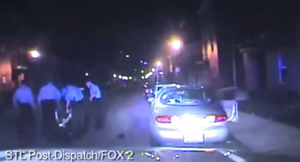 The video shows around seven cops dragging the suspect from a car onto the ground, beating him and kicking him while he resisted arrest.