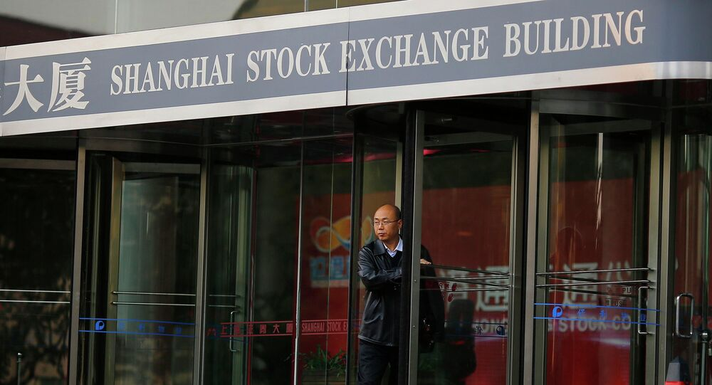 A man walks out of the Shanghai Stock Exchange building at the Pudong financial district in Shanghai