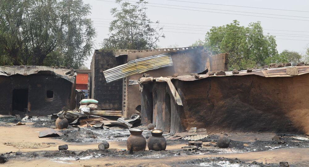 This photo shows razed homes in Mainok, outside Maiduguri, Borno State, Nigeria, on March 6, 2014
