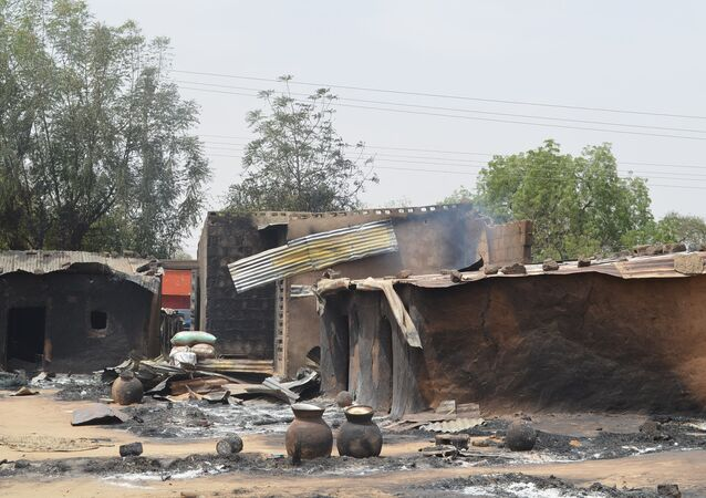 This photo shows razed homes in Mainok, outside Maiduguri, Borno State, Nigeria, on March 6, 2014