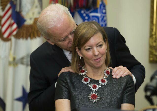 Vice President Joe Biden gets close to new Secretary of Defense Ashton Carter's wife Stephanie.