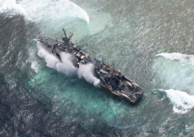 In this photo released by the Armed Forces of the Philippines Western Command (WESCOM), the USS Guardian is hit by a wave Saturday, Jan. 19, 2013 after running aground Thursday off Tubbataha Reef, a World Heritage Site in the Sulu Sea, 640 kilometers (400 miles) southwest of Manila, Philippines