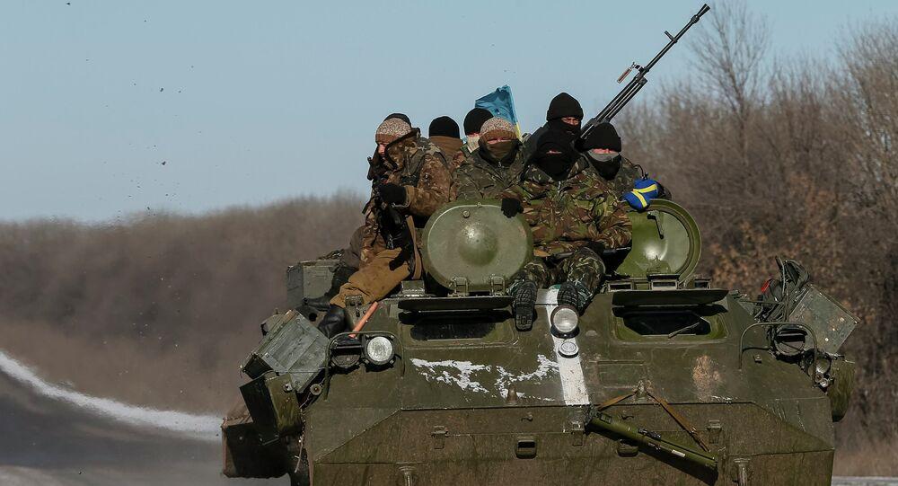 Members of the Ukrainian armed forces ride on a military vehicle near Debaltseve, eastern Ukraine, February 17, 2015