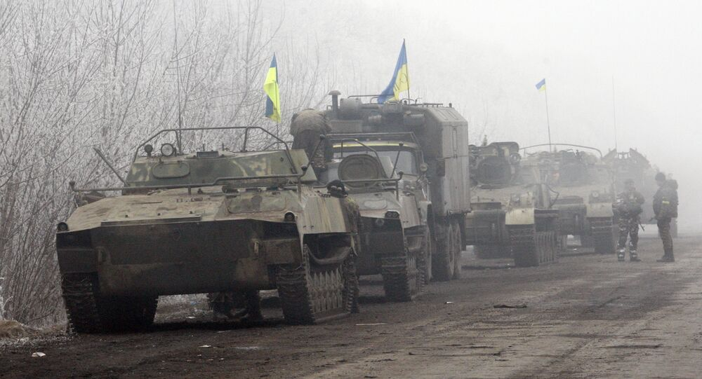 Ukrainian forces vehicles are seen parked on a road between Artemivsk and Debaltseve, Donetsk region, on February 15, 2015
