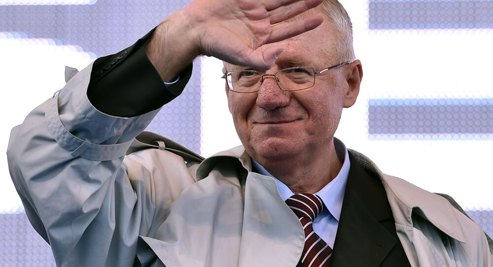 Serbian nationalist politician Vojislav Seselj waves to his supporters during an anti-government rally in Belgrade on November 15, 2014
