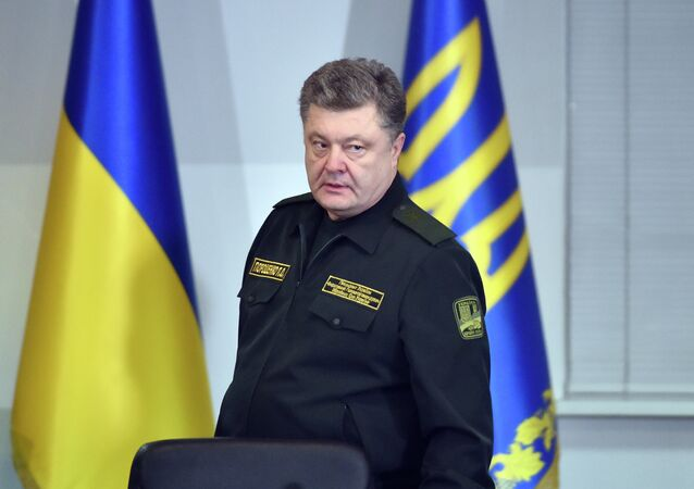 Ukrainian President Petro Poroshenko arrives for a live broadcast in Kiev to order the military to implement a ceasefire early on February 15, 2015