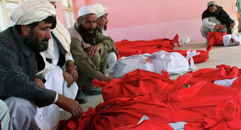 Bodies of civilians after a roadside bomb struck a small bus coming from a wedding, killing dozens, mostly women and children, in Ghazni province eastern of Kabul, Afghanistan