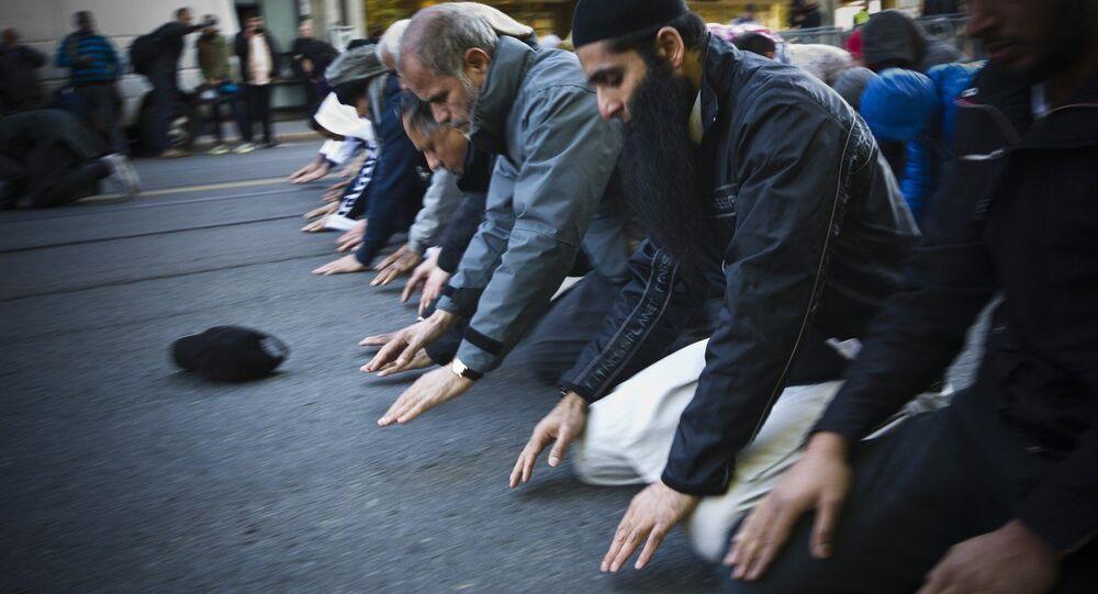 Muslim men pray