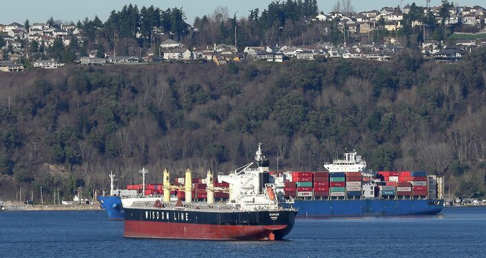 Ships sit anchored in Commencement Bay outside the Port of Tacoma in Washington State.