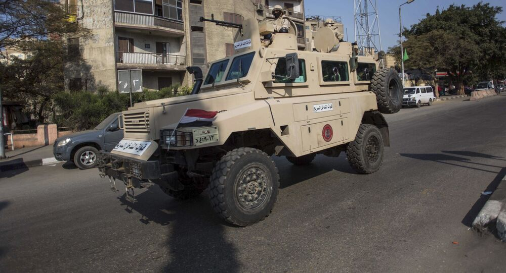 An Egyptian military vehicle patrols during anti-government demonstrations on Al Haram Street in Giza, a neighboring city of Cairo, Egypt, Friday, Nov. 28, 2014