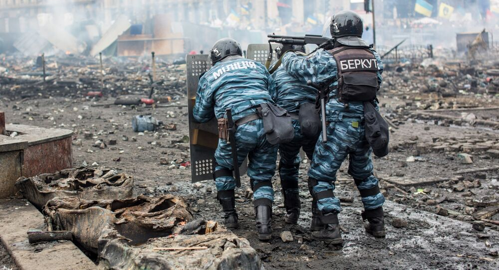 Police officers are seen on Maidan Nezalezhnosti square in Kiev, where clashes began between protesters and the police
