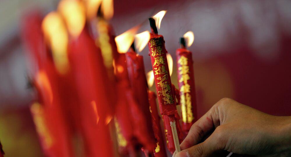 Ethnic Chinese people pray at Wat Mangkon Kamalawat Chinese Temple in Bangkok, Thailand Tuesday, Feb. 17, 2015. Chinese will celebrate the Lunar New Year