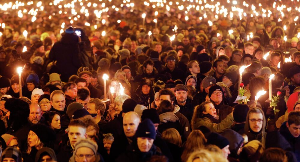 Hundreds of people gather for a vigil near the cultural club in Copenhagen, Denmark