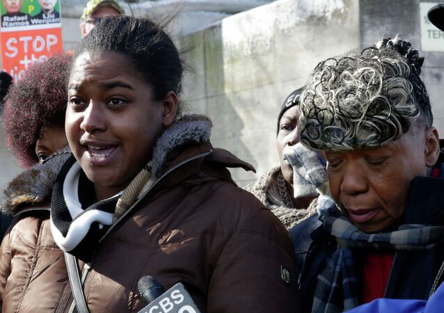 Erica Garner, left, daughter of chokehold death victim Eric Garner, and his mother Gwen Carr, talk to the press after attending a court hearing, in the Staten Island borough of New York, Thursday, Feb. 5, 2015.