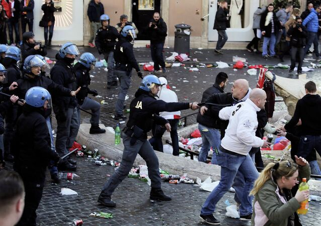 A policeman confronts Feyenoord fans