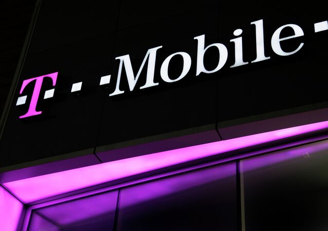 A sign for a T-Mobile store is displayed in New York