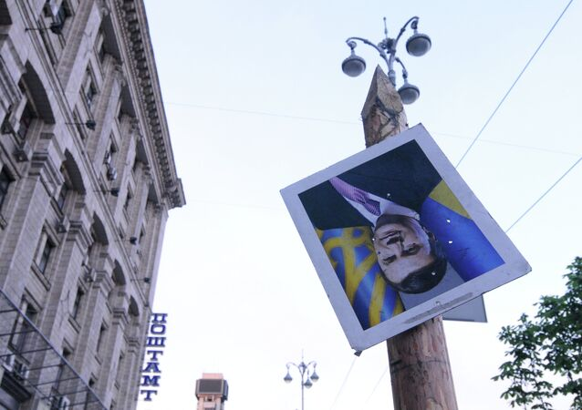 Portrait of ousted Ukrainian President Viktor Yanukovych on Independence Square in Kiev