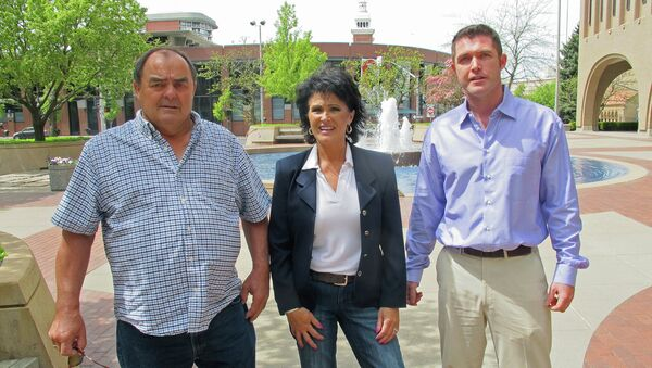 Larry Harvey, Rhonda Firestack-Harvey, and Rolland Gregg stand in the plaza in front of the federal courthouse in Spokane, Wash. The three are charged with growing marijuana at a remote farm near Kettle Falls, Wash. - Sputnik International