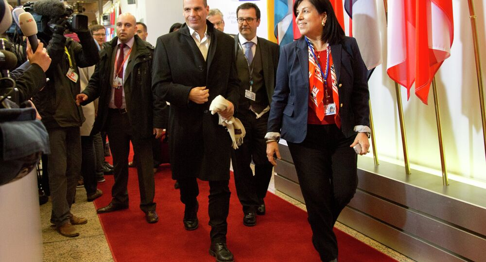 Greek Finance Minister Yanis Varoufakis, center, arrives for a meeting of eurogroup finance ministers in Brussels on Friday, Feb. 20, 2015.