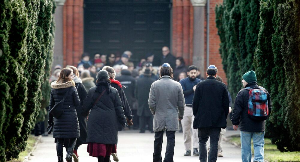 People arrive for the funeral of security guard Dan Uzan, a Jewish victim of the weekend's attack on a synagogue, in Copenhagen