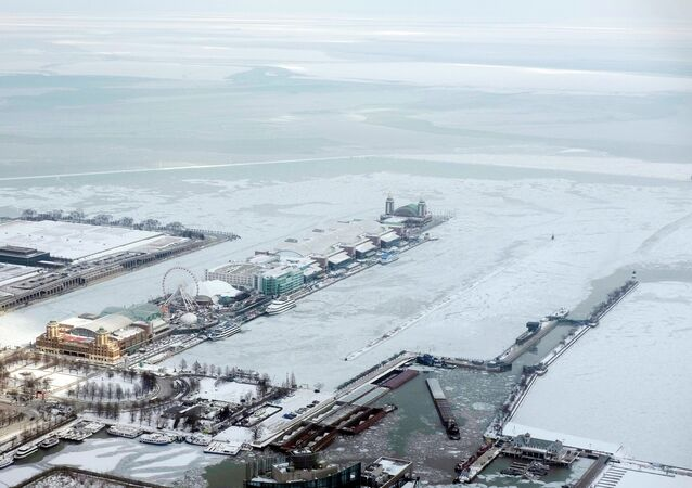 Snow coats Navy Pier surrounded by ice-covered Lake Michigan in Chicago.