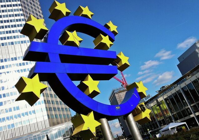 Euro sculpture stands in front of the European Central Bank, right, in Frankfurt, Germany.