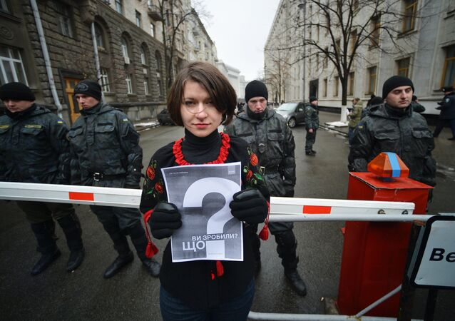 A participant of the rally A Year After. What Have Authorities Done? marking the anniversary of the events on Kiev's Independence Square