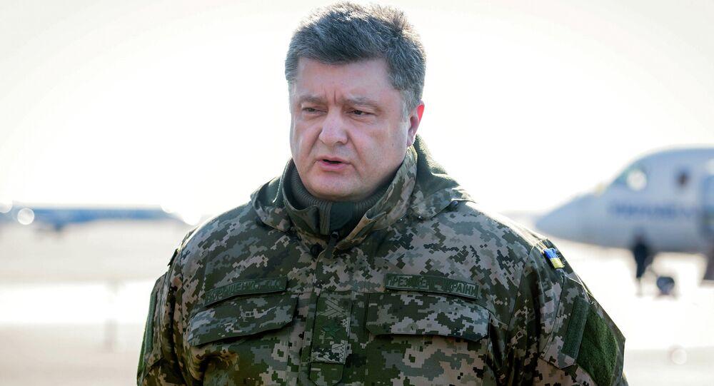Ukrainian President Petro Poroshenko makes a press statement before his flight to the military operation area