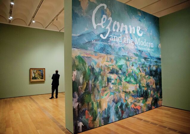 In this Oct. 14, 2014 photo, an enlarged mural based on painter Paul Cézanne's Mont Sainte-Victoire greets visitors entering the High Museum's new exhibit, Cezanne and the Modern: Masterpieces of European Art from the Pearlman Collection, in Atlanta.
