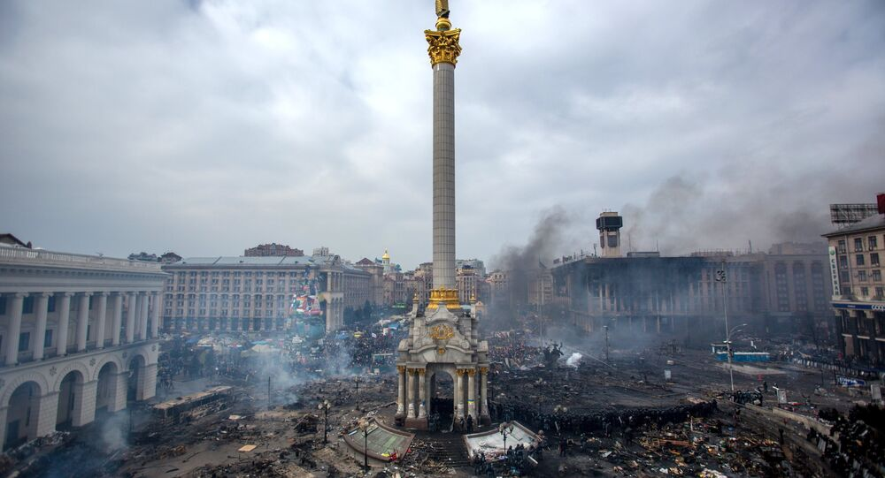 Fire, smoke and protesters on Maidan square in Kiev. February 22, 2014.
