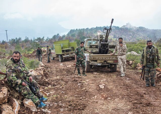Syrian soldiers on a mountain not far from the militants' positions near Kessab
