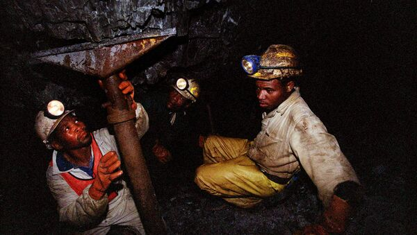 Miners work underground at the Harmony Goldmine, near Carletonville, South Africa, in this Wednesday Oct. 27, 2004 file photo. Some 3,000 miners were trapped underground when a water pipe burst and probably caused a shaft to collapse Wednesday, Oct. 3, 2007, in Harmony Gold's Elandsrand Mine near Johannesburg, South Africa's economic capital and gold-mining center - Sputnik International