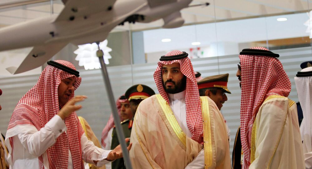 Then Saudi Defence Minister, Prince Mohammad bin Salman (C), visits the International Defence Exhibition and Conference (IDEX) in Abu Dhabi February 22, 2015.