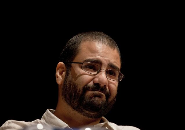 Egypt's most prominent activist Alaa Abdel-Fattah takes a moment as he speaks about his late father Ahmed Seif, one of Egypt's most respected human rights lawyers