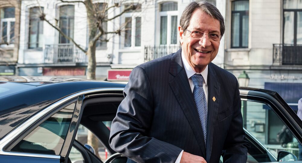 Cypriot President Nicos Anastasiades arrives for a meeting ahead of an EU summit in Brussels on Thursday, Feb. 12, 2015