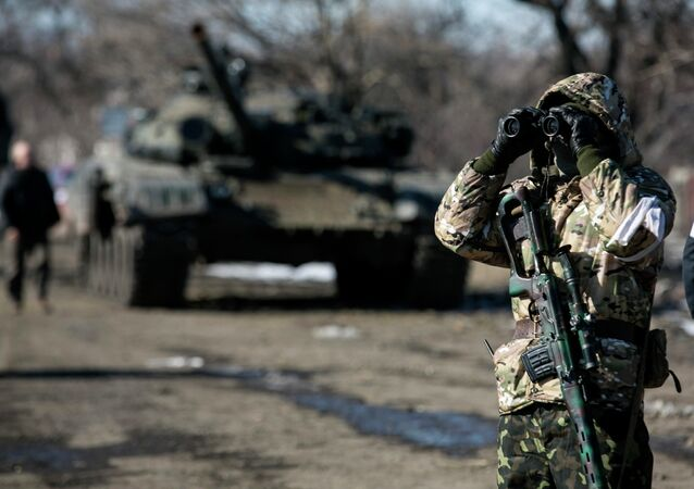 A fighter of the independence supporters of self-proclaimed Donetsk People's Republic Army uses a pair of binoculars at a checkpoint on the road from the town of Vuhlehirsk to Debaltseve February 18, 2015.