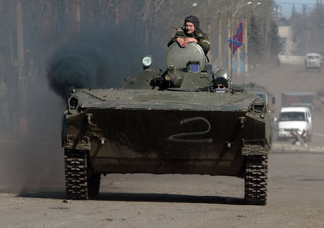 Independence supporters drive armoured personnel carrier (APC) in the eastern Ukrainian city of Debaltseve in the Donetsk region, on February 22, 2015