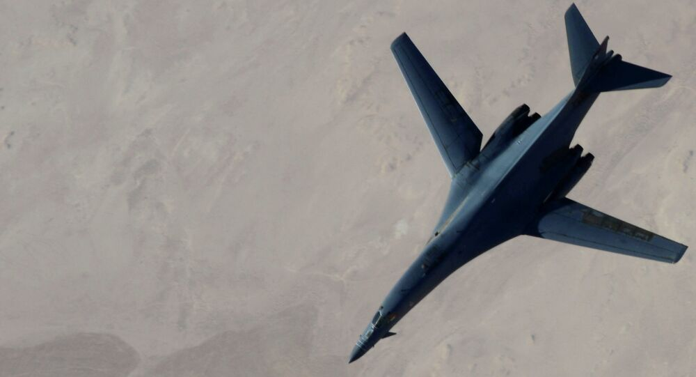 B-1B Lancer disengages from a KC-135 Stratotanker after refueling after airstrikes on ISIL jihadists in Syria