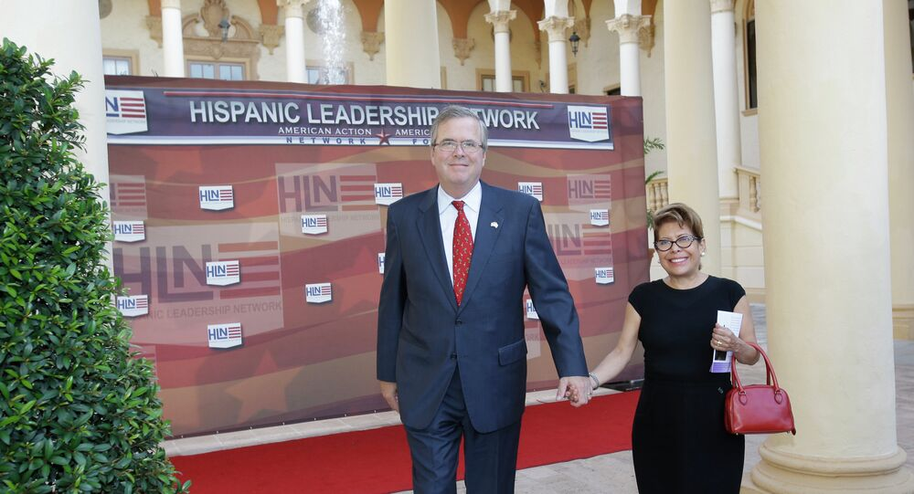 Former Fla. Gov. Jeb Bush and his wife Columba arrive at the Hispanic Leadership Network conference in 2013.