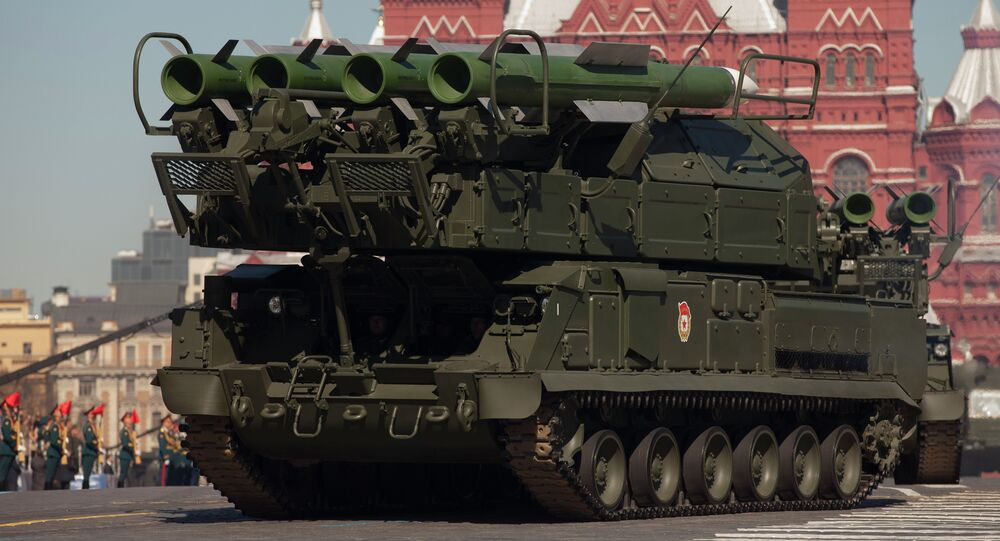 Russian Buk air defense missile systems make their way through Red Square during a rehearsal for the Victory Day military parade in Moscow