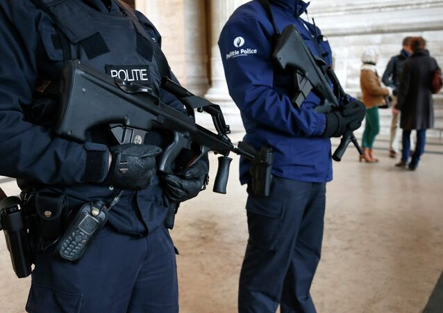 Belgian police officers stand guard outside the Palace of Justice in Brussels