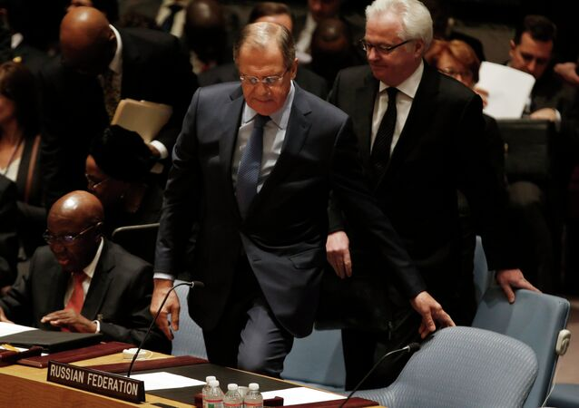 Russian Foreign Minister Sergey Lavrov takes his seat for a meeting of the United Nations Security Council at the U.N. headquarters in New York, February 23, 2015. At right is Russian Ambassador to the United Nations Vitaly Churkin