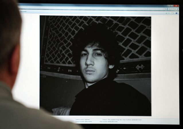 A man looks in Moscow on April 19, 2013, at a computer screen displaying an undated picture the 19-year-old Dzhokhar Tsarnaev posted on his is page in VKontakte, a Russian social media site