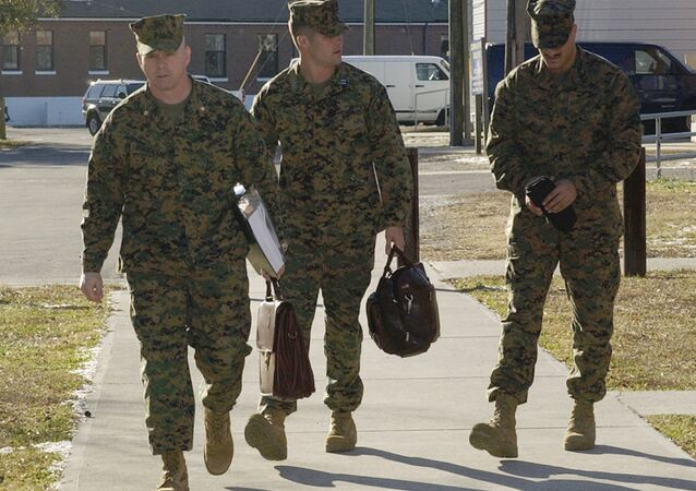 Cpl. Wassef Ali Hassoun, right, walks with defense attorneys Maj. Phillip E. Stackhouse, left, and Capt. Brandon Bolling for the first day of the Article 32 pre-trial investigation, Tuesday, Dec. 21, 2004, at Camp LeJeune, N.C. Hassoun is charged with desertion after he disappeared from his unit in Iraq and later claimed to be kidnapped.