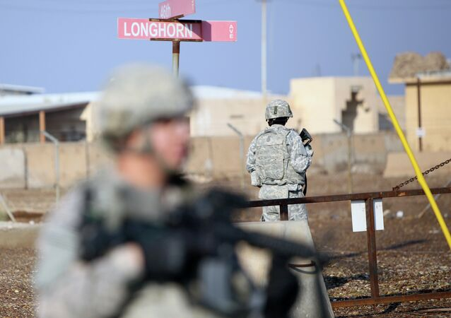 US soldiers stand guard at the Taji base complex which hosts Iraqi and US troops and is located thirty kilometres north of the capital Baghdad