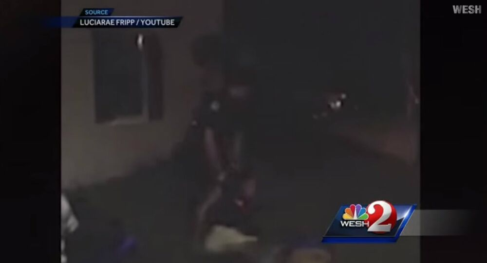 Holloway beaten and dragged by  former Officer Escobar