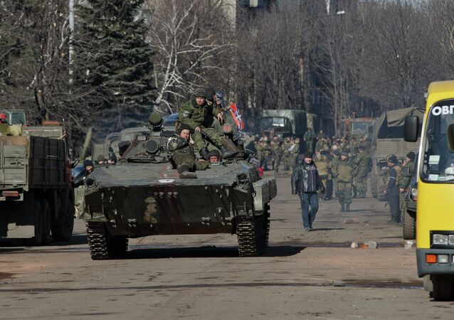 Independence supporters ride on an armored vehicle in the center of Debaltseve, Ukraine, Monday, Feb. 23, 2015
