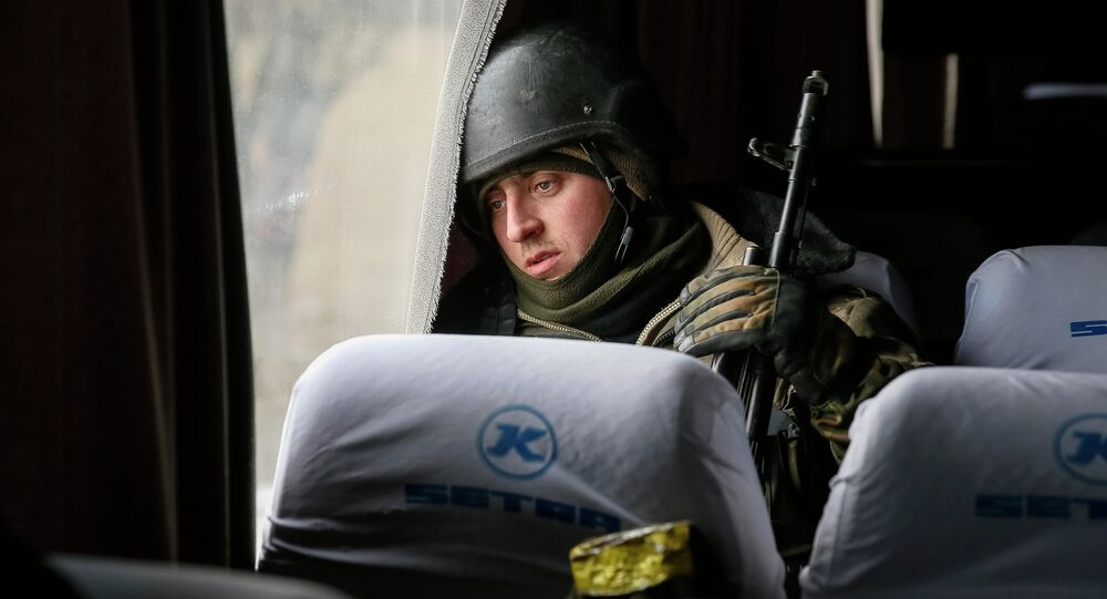 A Ukrainian serviceman who fought in Debaltseve is seen in a bus before leaving for his home, near Artemivsk February 19, 2015