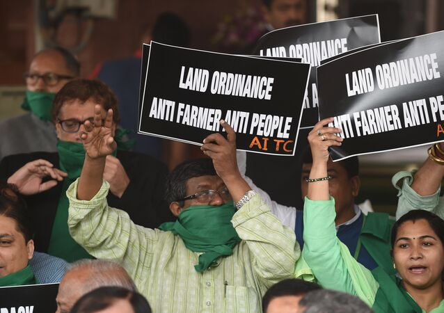 Member of Parliament of All India Trinamool Congress Party shout slogans against a proposed Land Acquisition bill at Parliament House in New Delhi on February 24, 2015