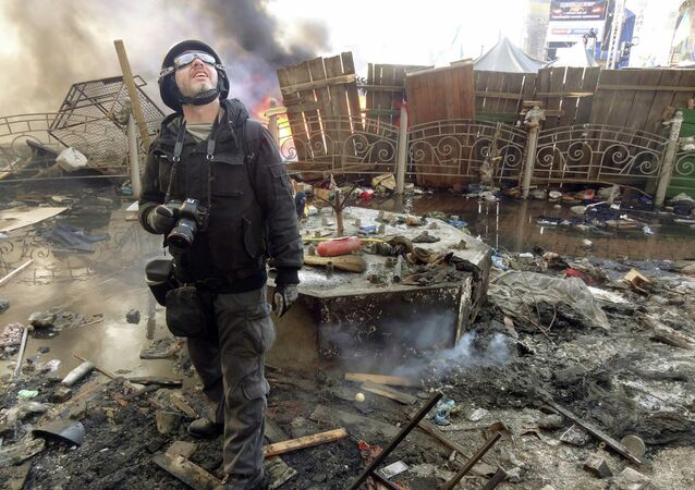 Undated file picture taken in Kiev shows Andrei Stenin, a photographer working for the Russian press agency RIA Novosti